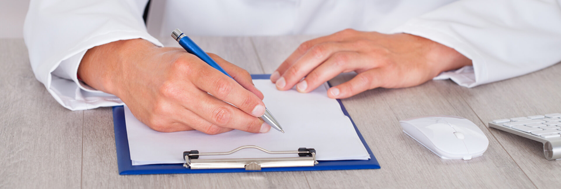 Doctor writing on a statement board