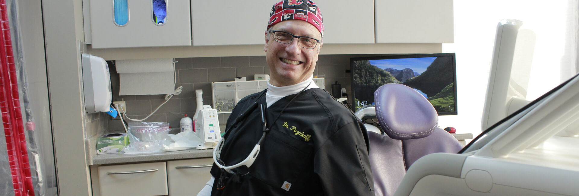 Dr. Kenneth Poznikoff smiling at the camera