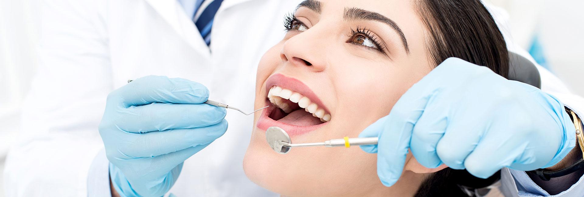 Dentist examine patient teeth